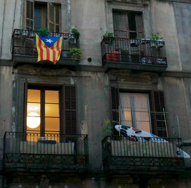 The Catalan Flag hangs from a balcony in Barcelona
