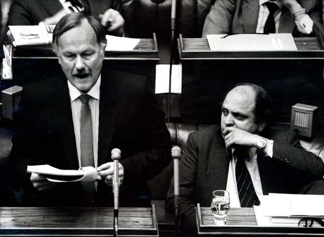Roger Douglas reads the 1984 budget in New Zealand. (Te Ara Encyclopedia)